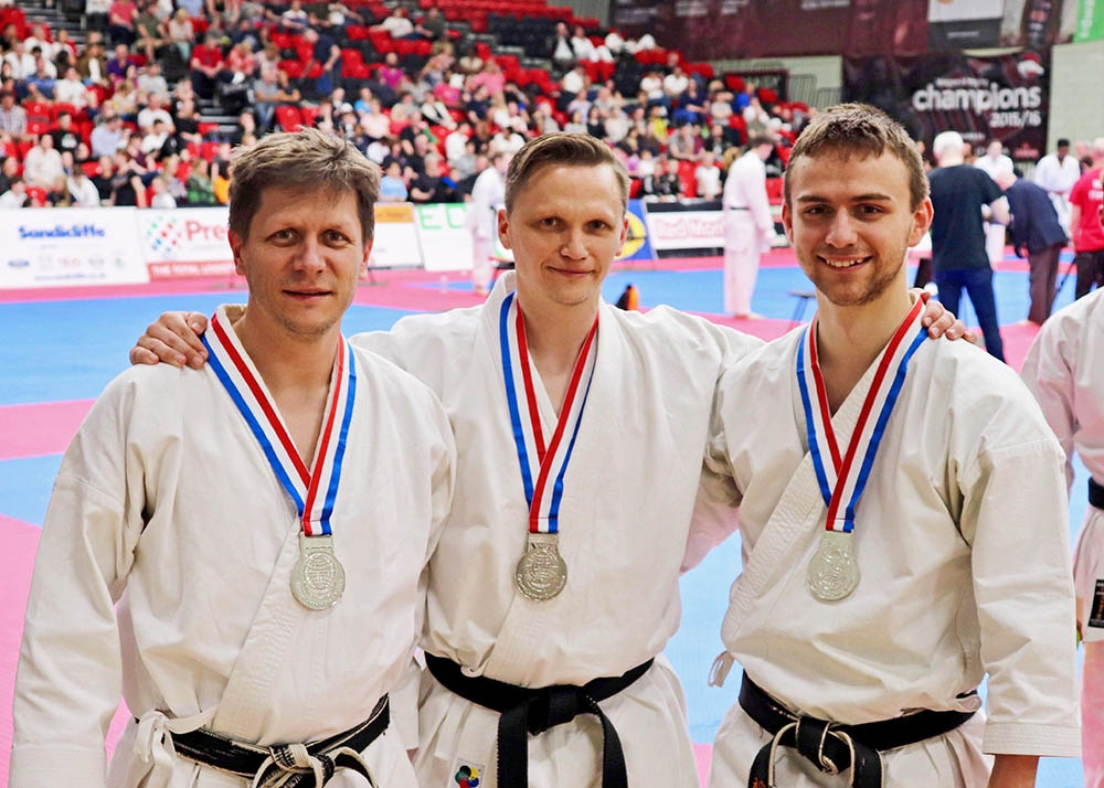 National team kata medallists Dan Salter, Tim Griffiths and Steven Connell